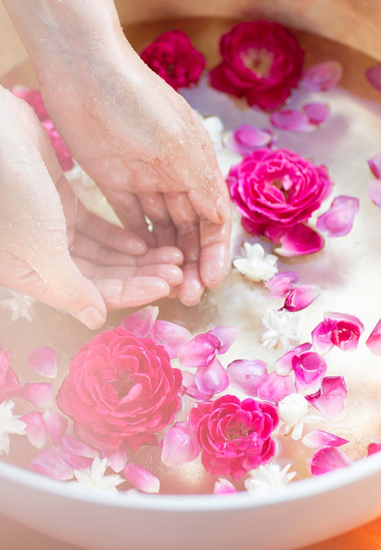 spa hands in petal water